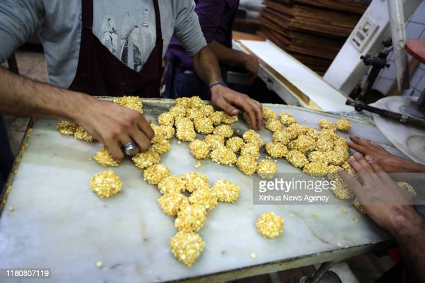 TANTA Nov 3 2019 People make candies in Tanta Egypt Nov 3 2019 Shops and stalls of traditional sugar candies with various shapes and colorful covers...