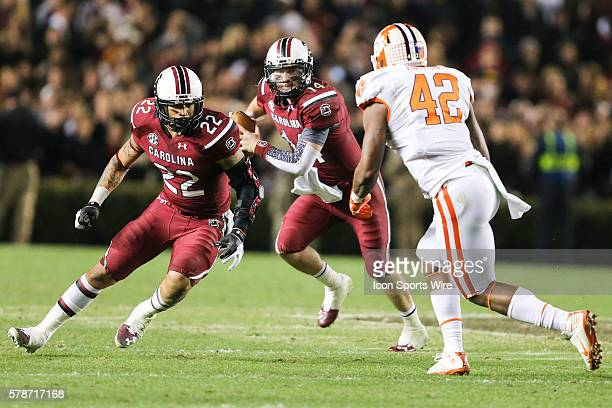 South Carolina Gamecocks quarterback Connor Shaw follows the block of running back Brandon Wilds as Clemson Tigers linebacker Stephone Anthony comes...