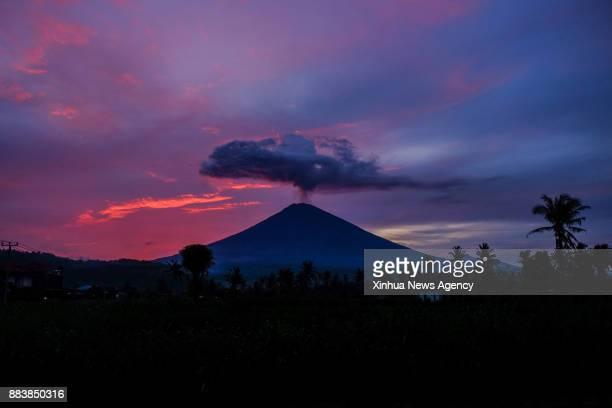 BALI Nov 30 2017 Mount Agung spews volcanic ash in Amed village Karangasem district Bali Indonesia Nov 30 2017