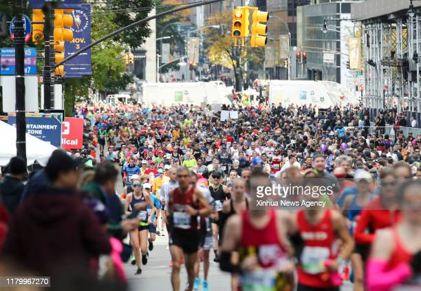 Nov. 4, 2019 -- Participants compete during the 2019 TCS New York City Marathon in New York, the United States, Nov. 3, 2019. Over 50,000...