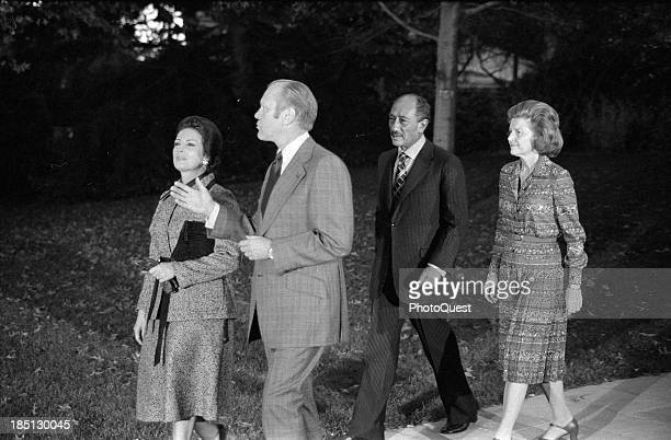 Nov 5 1975 President Gerald Ford walking with Egyptian President Anwar Sadat Sadat's wife Jihan and Betty Ford during the Sadat's visit to the United...