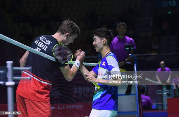 FUZHOU Nov 5 2019 Viktor Axelsen L of Denmark shakes hands with Kanta Tsuneyama of Japan after their men's singles first round match at the Fuzhou...