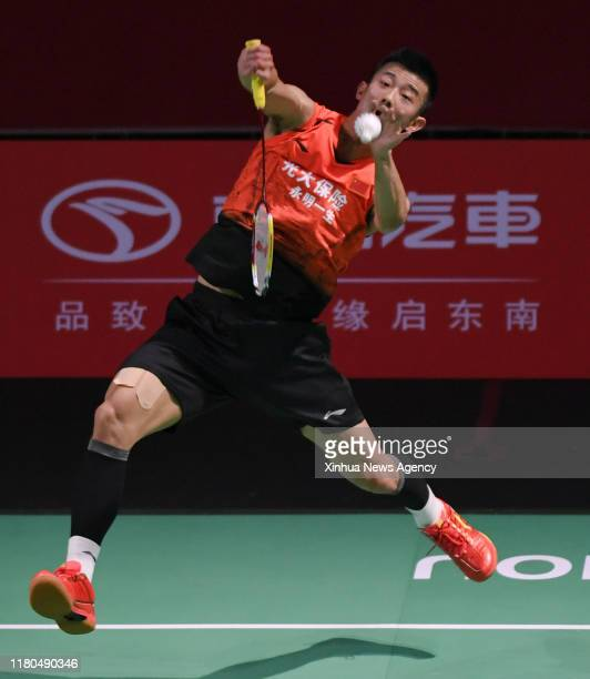 FUZHOU Nov 6 2019 Chen Long of China hits a return during the men's singles first round match between Chen Long of China and Lin Dan of China at the...