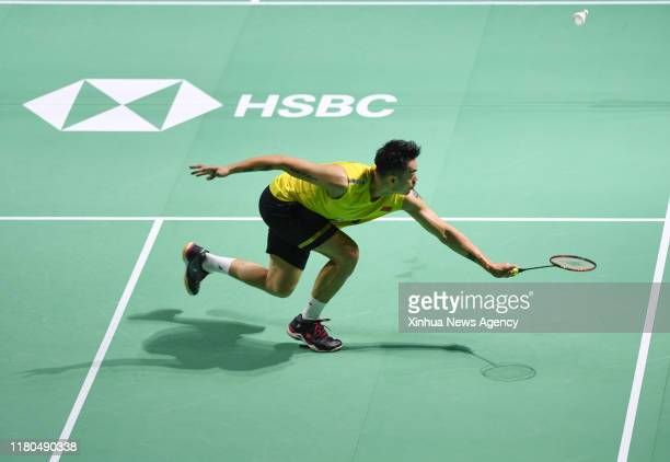 FUZHOU Nov 6 2019 Lin Dan of China hits a return during the men's singles first round match between Chen Long of China and Lin Dan of China at the...