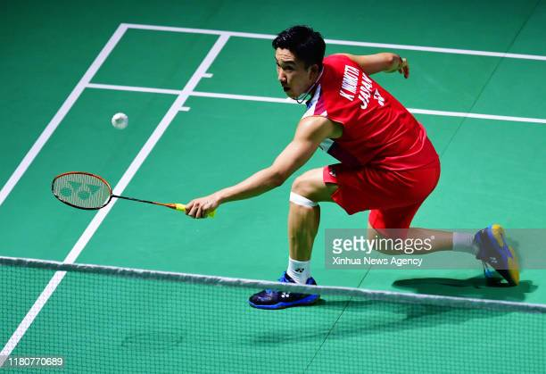 FUZHOU Nov 7 2019 Kento Momota of Japan hits a return during the men's singles second round match between Kento Momota of Japan and Lee Zii Jia of...