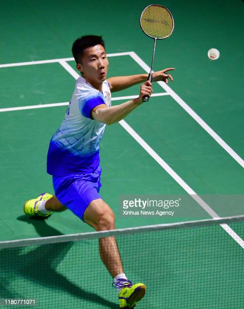 FUZHOU Nov 7 2019 Lu Guangzu of China hits a return during the men's singles second round match between Chen Long of China and Lu Guangzu of China at...