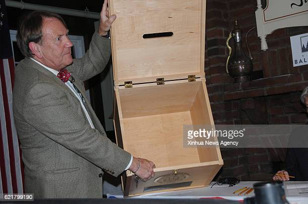 NOTCH Nov 8 2016 A stuff member shows an empty ballot box at a polling station in Dixville Notch New Hampshire the United States Nov 8 2016 Voters in...