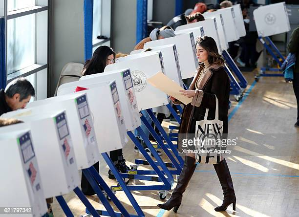NEW YORK Nov 8 2016 A voter walks to a booth to fill in her ballot at a polling station in Brooklyn New York the United States on Nov 8 2016 American...