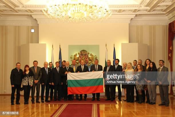 SOFIA Nov 8 2017 Bulgarian President Rumen Radev and some members of the expedition team to Antarctica pose for photos in Sofia capital of Bulgaria...