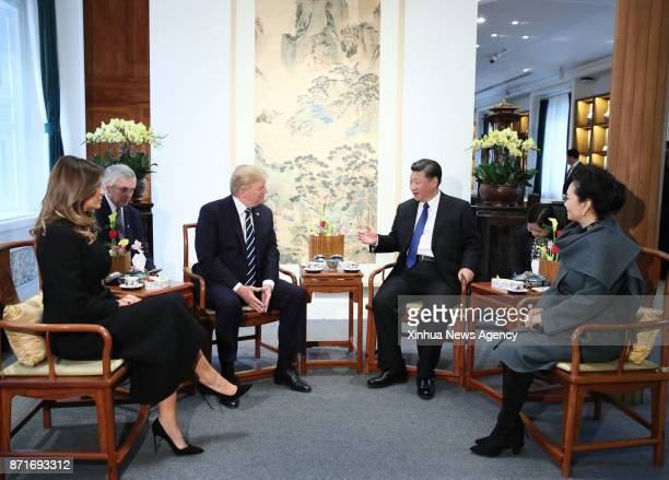Chinese President Xi Jinping and his wife Peng Liyuan and US President Donald Trump and his wife Melania Trump have an informal afternoon tea in the...