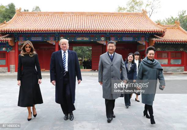 Chinese President Xi Jinping and his wife Peng Liyuan welcome US President Donald Trump and his wife Melania Trump at the Palace Museum or the...