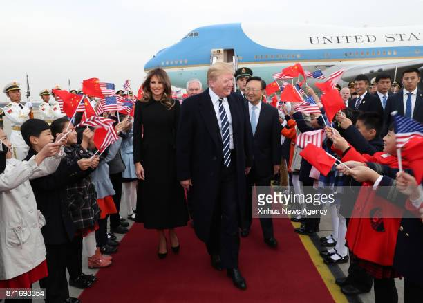 US President Donald Trump greeted by Chinese State Councilor Yang Jiechi arrives in Beijing on Nov 8 starting his state visit to China