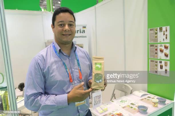 SHANGHAI Nov 8 2018 Alexandre Santos a Mozambican businessman shows the organic Moringa tea at his booth at the first China International Import Expo...