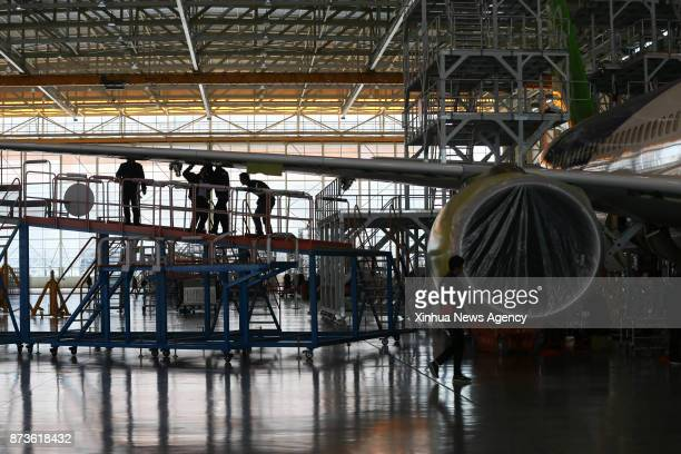 SHANGHAI Nov 9 2017 Staff members work on China's large passenger aircraft the C919 at the assembly line in Shanghai east China Nov 9 2017 A second...