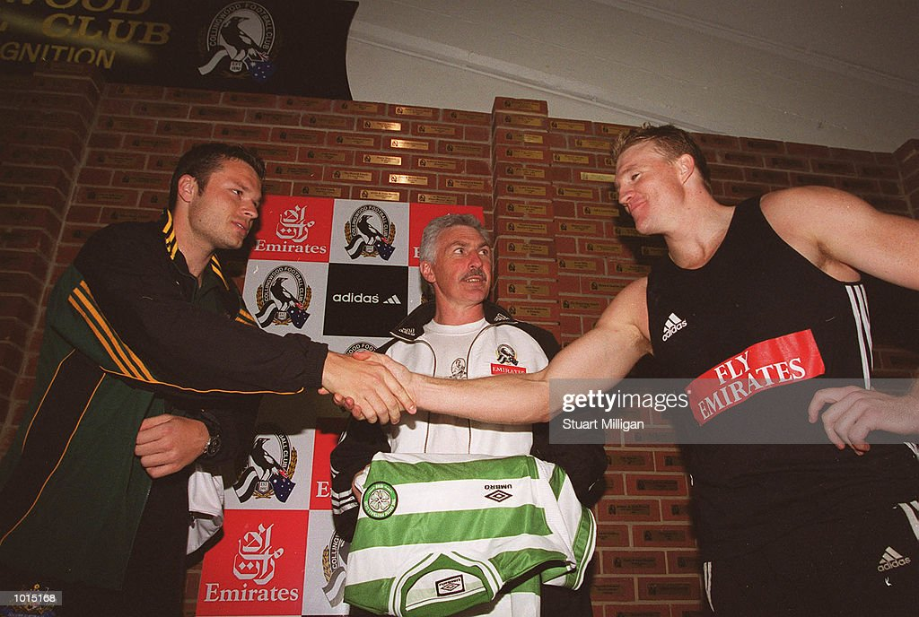 Mark Viduka, Australian Soccer Star ( left) is introduced to AFL Star and Collingwood Captain Nathan Buckley, ( right ) as Mick Malthouse, Collingwood Coach looks on at Victoria Park, Melbourne Australia Mandatory Credit: Stuart Milligan/ALLSPORT