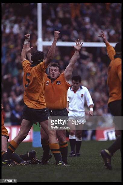John Eales and Tony Daley of Australia celebrate victory over England in the Rugby World Cup final of 1991 which was held in England