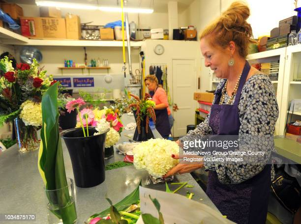Scott Varley Los Angeles Newspaper Group Nova Freels right and Maria Boone fill orders and makes arrangements at Freel's San Pedro flower shop Fleur...