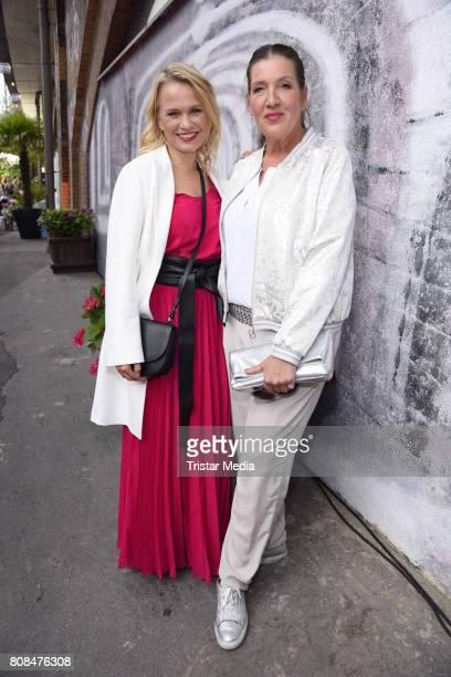 Nova Meierhenrich and Katy Karrenbauer attend the Riani Fashion Show Spring/Summer 2018 at Umspannwerk Kreuzberg on July 4 2017 in Berlin Germany