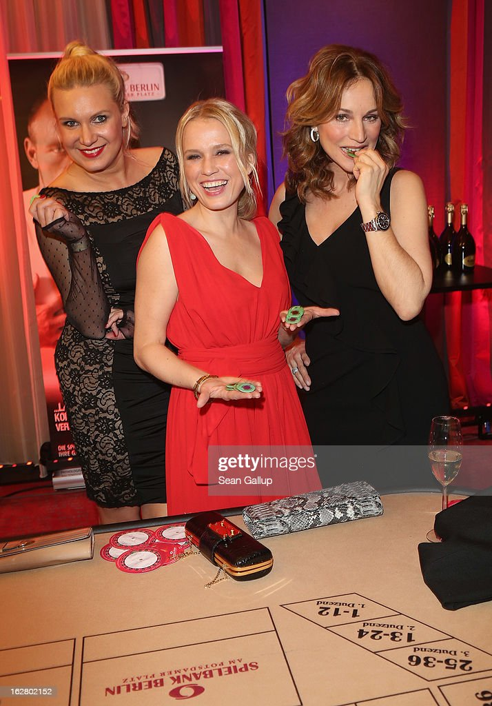 Nova Meierhenrich, Magdalena Brzeska and Caroline Beil attend the grand opening of the Waldorf Astoria Berlin hotel on February 27, 2013 in Berlin, Germany.