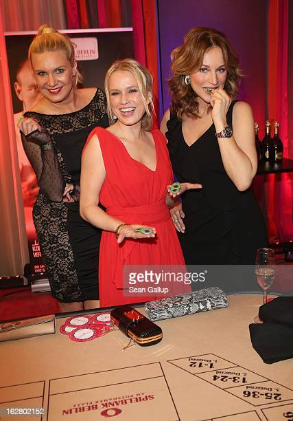 Nova Meierhenrich, Magdalena Brzeska and Caroline Beil attend the grand opening of the Waldorf Astoria Berlin hotel on February 27, 2013 in Berlin,...