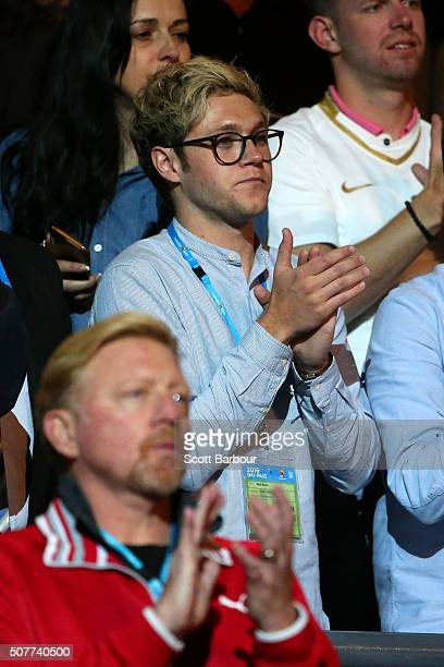 Novac Djokovic's coach Boris Becker and Niall Horan from the band One Direction applaud Novak Djokovic of Serbia's win over Andy Murray of Great...