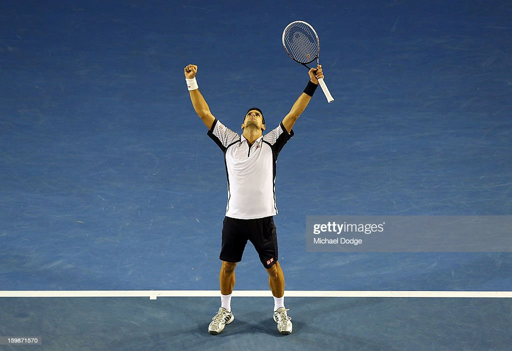 Novak Djockovic of Serbia celebrates match point in his Quarterfinal match against Thomas Berdych of The Czech Republic during day nine of the 2013 Australian Open at Melbourne Park on January 22, 2013 in Melbourne, Australia.
