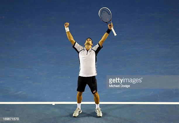 Novak Djockovic of Serbia celebrates match point in his Quarterfinal match against Thomas Berdych of The Czech Republic during day nine of the 2013...