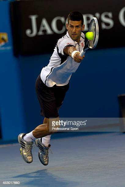 Novak Djockovic of Serbia in action during in his quarter-final match against Thomas Berdych of The Czech Republic on day nine of the 2013 Australian...