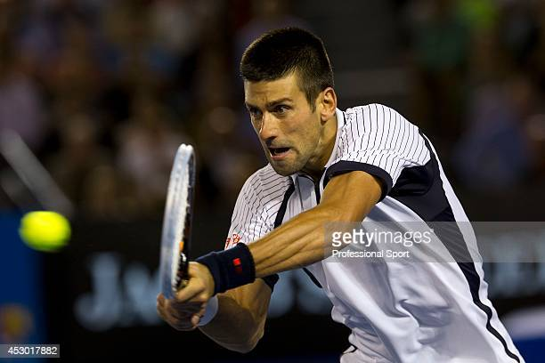 Novak Djockovic of Serbia playing a two-handed backhand during in his quarter-final match against Thomas Berdych of The Czech Republic on day nine of...