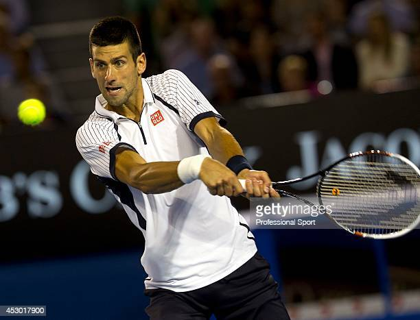 Novak Djockovic of Serbia plays a two-handed backhand during in his quarter-final match against Thomas Berdych of The Czech Republic on day nine of...