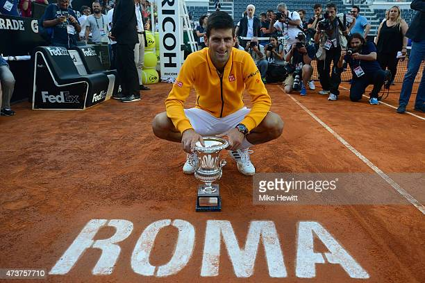 Novak Djokavic of Serbia holds the Winner's Trophy after his victory over Roger Federer of Switzerland in the Men's Singles Final on Day Eight of The...