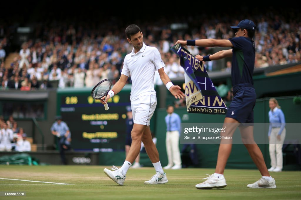 Novak Djokovic Accepts A Towel From A Ball Boy During His Gentlemen S News Photo Getty Images
