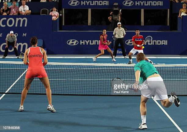 Novak Djokovic and Ana Ivanovic of Serbia play Andrey Golubev and Yaroslava Shvedova of Kazakhstan during their mixed doubles match on day two of the...