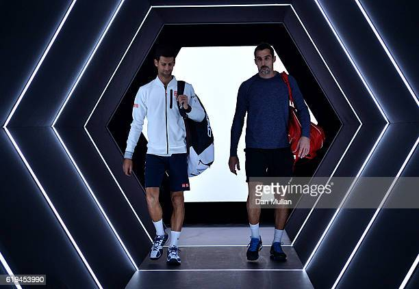 Novak Djokovic and Nenad Zimonjic of Serbia make their way on court for their Mens Doubles match against Quentin Halys and Adrian Mandarin of France...