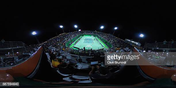Novak Djokovic and Nenad Zimonjic of Serbia play during the Men's Doubles second round match against Bruno Soares and Marcelo Melo of Brazil on Day 3...