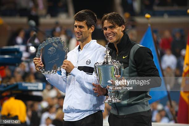 Novak Djokovic and Rafael Nadal pose for photos after the men's final on day fifteen of the 2010 US Open at the USTA Billie Jean King National Tennis...