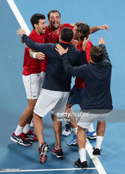 Novak Djokovic and Viktor Troicki of Serbia and team mates celebrates winning match point during their final doubles match against Feliciano Lopez...