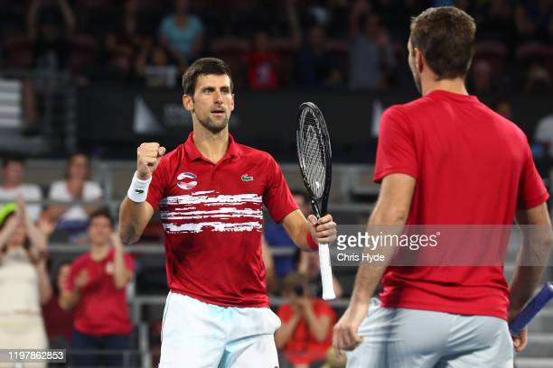 Novak Djokovic and Viktor Troicki of Serbia celebrate in the doubles match against Nicolas Mahut and Edouard Roger-Vasselin of France during day four...