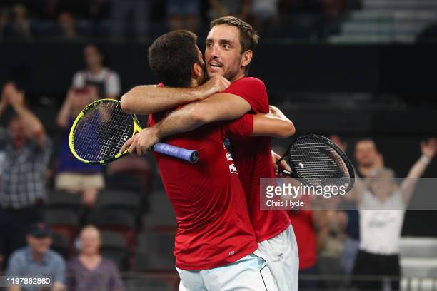 Novak Djokovic and Viktor Troicki of Serbia celebrate winning the doubles match against Nicolas Mahut and Edouard RogerVasselin of France during day...