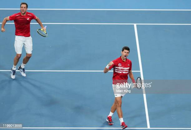 Novak Djokovic and Viktor Troicki of Serbia celebrates winning set point during their final doubles match against Feliciano Lopez and Pablo Carreno...