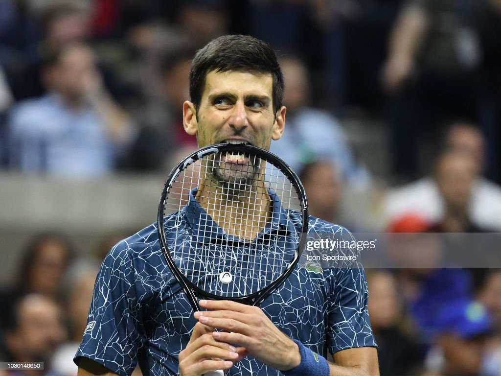 Novak Djokovic (SRB) bites his racquet after loosing a point to Juan Martin del Potro (ARG) in the final of the Men's Singles Championships at the US Open on September 09, 2018, played at the Billie Jean King Tennis Center in Flushing Meadow, NY.