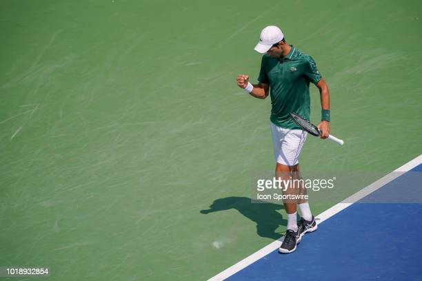 Novak Djokovic celebrates after winning a point during the semifinal match at the Western Southern Open at the Lindner Family Tennis Center in Mason...