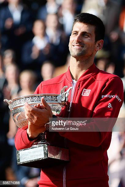 Novak Djokovic celebrates victory with trophy during the day fifteen of the French Open 2016 at Roland Garros on June 5 2016 in Paris France