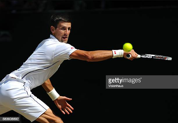 Novak Djokovic during his SemiFinal match against Grigor Dimitrov on Day Eleven of the 2014 Wimbledon Tennis Championships at the All England Lawn...