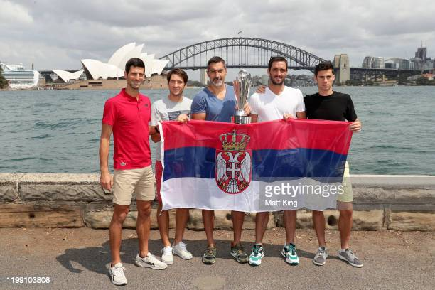 Novak Djokovic, Dusan Lajovic, Nenad Zimonjic, Viktor Troicki and Nikola Cacic of Team Serbia pose with the ATP Cup during a media opportunity after...