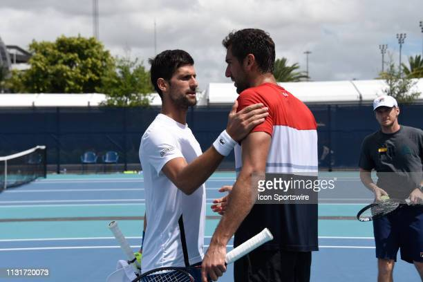 Novak Djokovic finishes practice with Marin Cilic during the Miami Open on March 20 2019 at Hard Rock Stadium in Miami Gardens FL