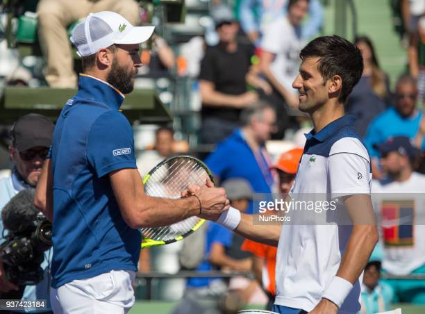 Novak Djokovic from Serbia congratulates Benoit Paire from France Djokovic after his victory 63 64 for the second round of the Miami Open in Key...