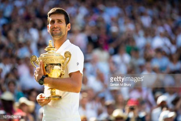 Novak Djokovic from Serbia with winners trophy after defeating Kevin Anderson from South Africa in the Men's Singles Final The Wimbledon Lawn Tennis...