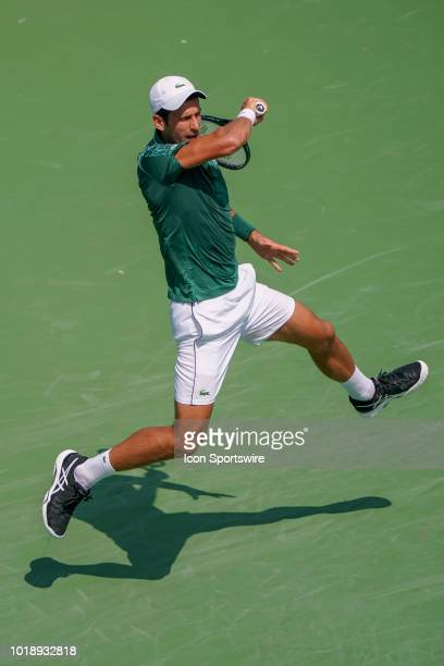 Novak Djokovic gets airborne on a return shot during the semifinal match at the Western Southern Open at the Lindner Family Tennis Center in Mason...