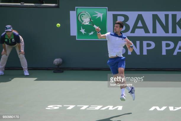 Novak Djokovic hits a forehand during the BNP Paribas Open on March 11 2018 at the Indian Wells Tennis Garden in Indian Wells CA